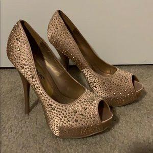 Gold embellished peep toe stilettos